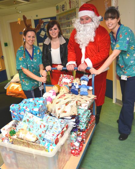 Hunts Post readers presents, delivered to Holly Ward, at Hinchingbrooke Hospital, by (l-r) Play Lead