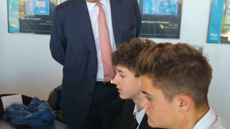 Year 10 Meridian Upper School students William Mitchell and Jonny Gambell are watched by the Duke of