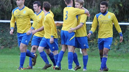 Harpenden players congratulate Harry Hunt after his opening goal against Hatfield Town. Picture: MEL