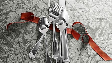 Cutlery on a vintage wine-themed tablecloth from Williams Sonoma