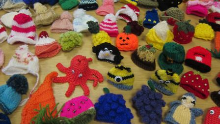 Some of the hats already knitted by people for Age Concern.