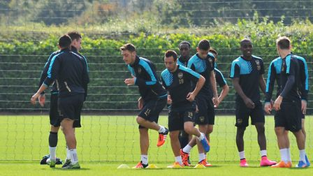 Arsenal warm up before training at London Colney grounds