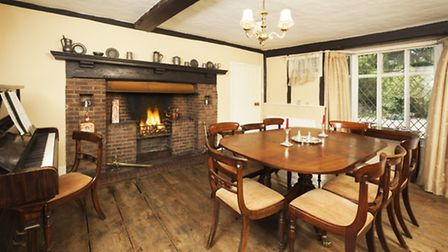 Dine in front of the traditional open hearth