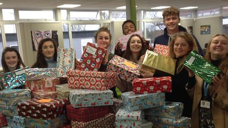 St Ivo Sixth Form pupils and their Christmas boxes.