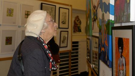 Harpenden Arts Club exhibition - Olive Yeo of Harpenden, intently studying an acrylic painting Wake