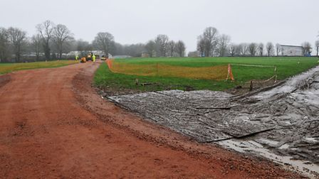 A new temporary road surface is being laid across the playing field for residents living on Fontmell