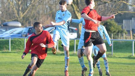 Eaton Socon and Brampton players try to use their heads in a Hunts Intermediate Cup semi-final last