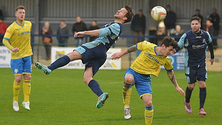 Adam Tann (centre) scored a late own goal as St Neots Town were thumped by Chippenham.