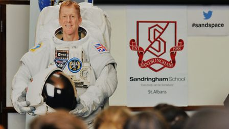 A cardboard cutout of astronaut Tim Peake stands in front of the audience at the Sandringham School