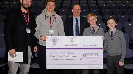 Andy and Owen Farrell receive a cheque from Aldwickbury School headmaster Vernon Hales and year 8 pu