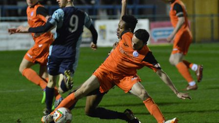 Peter Clark in action against St Neots Town last week - now he has signed for them. Picture: HELEN D