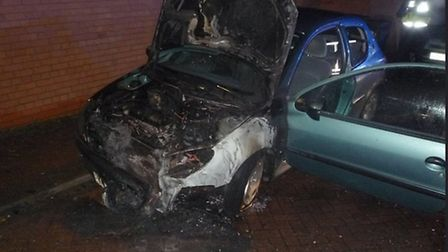 Arsonists set fire to a car in Huntingdon.
