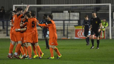 St Ives Town players celebrate Peter Clark's opening goal against St Neots Town last night. Picture:
