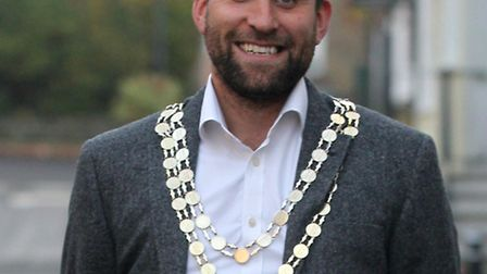 Mayor Ben Lewis is inviting guests to a tea party.