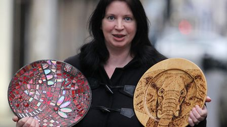 Lisa Stanway pictured with her art work, which is being displayed in Curwens, Royston