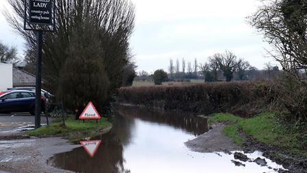 The flooded Dyke Lane next to the Wicked Lady pub