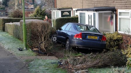 The car which ended up in a front garden after hitting a parked van