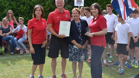 Jan Wood (in blue) has received a HSP Lifetime Achievement Award for her work in sport