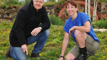 Eastenders and Strictly Come Dancing star Jake Wood helps Butterfly World volunteer Jill Hesketh pla