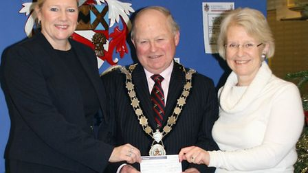 Barbara Berki, William Hill, and the Town Mayor, Councillor Brian Ellis, presenting a cheque to Tere