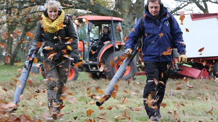 BBC Countryfile presenter Ellie Harrison and Jody Wilson, Mid-Herts Golf Club course manager, strap