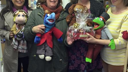 Laura Whitford received the Christmas Hamper after winning the Royston Means Business window display