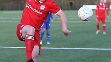 Jon Clements (in red) helped London Colney defeat rivals Colney Heath. Picture: JIM WHITTAMORE
