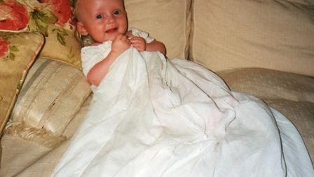 The family christening robe - pictured being worn by Louise's son David - was also stolen.