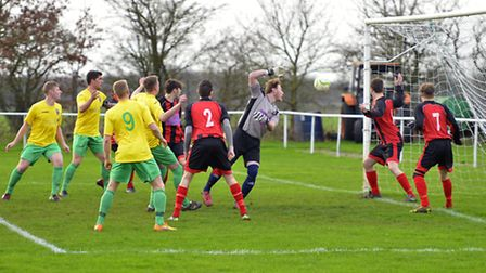 Goalmouth action from Huntingdon's 6-1 defeat against Wisbech on Bank Holiday Monday. Picture: DUNCA