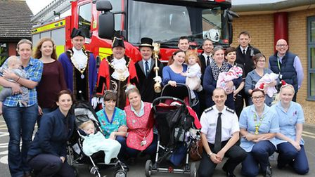 Firefighters and the mayor and deputy mayor of Huntingdon distribute presents
