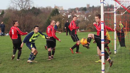 A Royston Rangers defender clears a Cannon Res shot from off the line