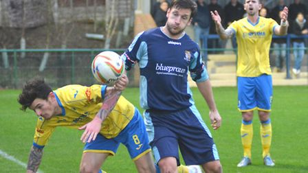 St Neots Town player Adam Tann battles for the ball during their 1-0 home defeat against King's Lynn