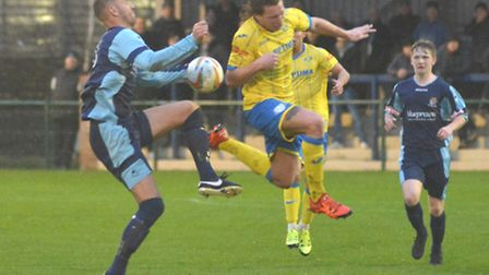 Mat Mitchel-King battles for the ball during St Neots Town's defeat to King's Lynn. Picture: HELEN D