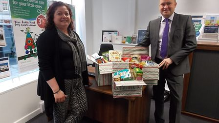Emma Dalton from St Albans District Foodbank and Glynn Pope from Harrison Murray in St Albans
