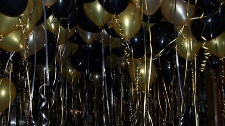 Fill the space above you with glistening balloons to create a canopy of celebration