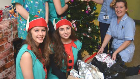 Abbey College students donate presents to Holly Ward, at Hinchingbrooke Hospital, ( l-r) Elf studen