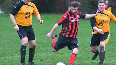 Marc Puckering (centre) scored for Houghton & Wyton in their victory against Mildenhall United. Pict