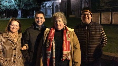 American participants in the Royston Ghost Walk outside St John's Church