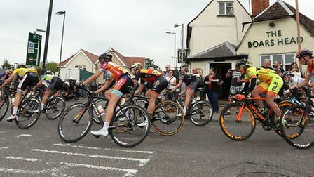The peloton make the turn outside The Boars Head pub in Royston during the Aviva Women's Tour. Pictu