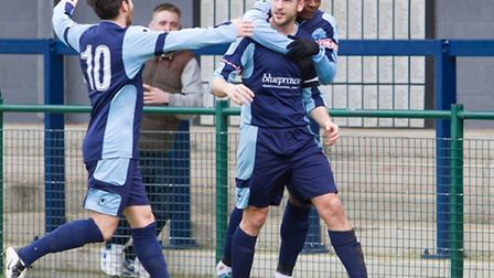 Adam Tann (centre) celebrates scoring for St Neots Town in their home defeat against Redditch. Pictu