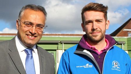 Finlay Mitchell with Sab Bhandal of Harpenden Smiles, who are sponsoring the Harpenden golf pro