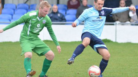 Micky Hyem hit one of the goals as Godmanchester Rovers sank leaders Norwich United.