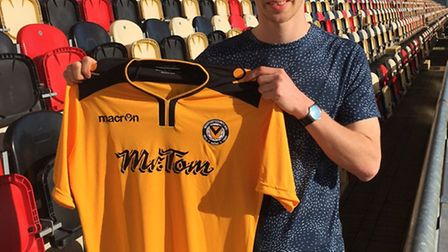 Tom Meechan signs for Newport County. Picture: NEWPORT COUNTY AFC