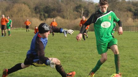 Marshalswick Rovers keeper Dan Upwood comes out to thwart Phoenix 'A' two-goal hero Sam Bozier
