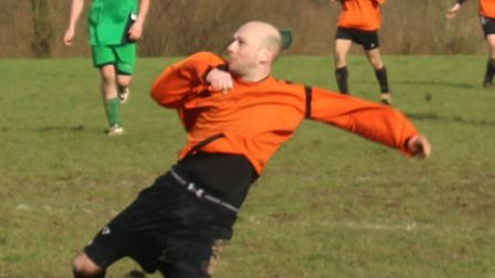 Chris Potter of Marshalswick Rovers heads clear a Phoenix 'A' threat