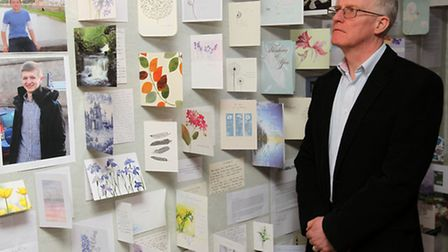 Steve Mallen next to wall of cards in memory of his son