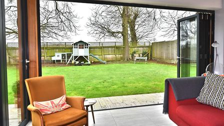 Bi-fold doors, opening up a living space, bringing the outside in