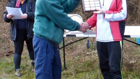 Seonaid Dudley (right) receives the W75 title at the East Anglian Championships.