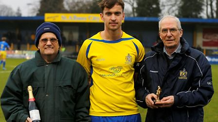 Sam Corcoran is presented with his award for January. Picture: LEIGH PAGE