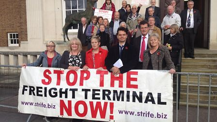 Herts Ad editor Matt Adams, Anne Main MP and Cllr Sandy Walkington with rail freight campaigners out